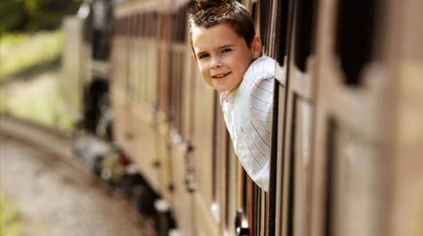 A boy riding on the train at East Lancashire Railway