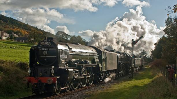 Steam train passing through Irwell Vale