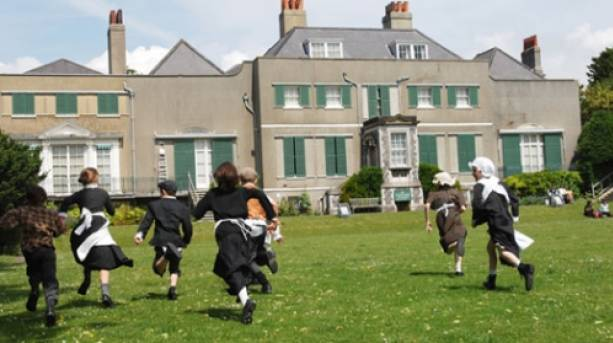 Children in period dress running in the grounds of Preston Manor, rumoured to be haunted by the White Lady
