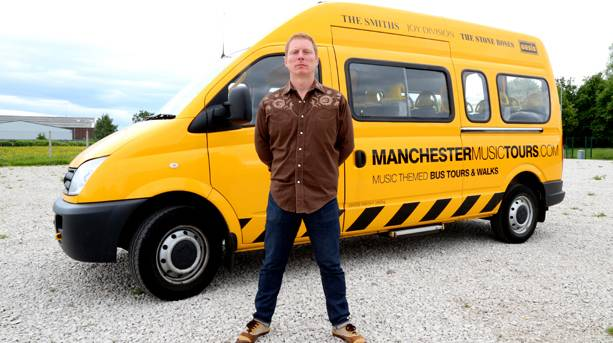Craig Gill in front of tour bus