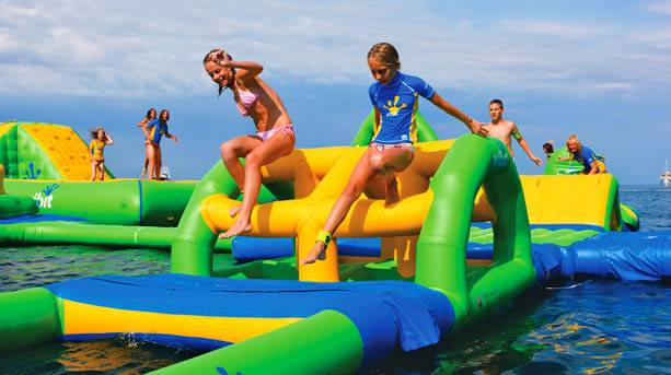 Children on inflatable bars at the Waterpark