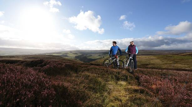 A couple cycling in the Durham Dales