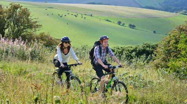 Two people cycling through the Seven Sisters Country Park