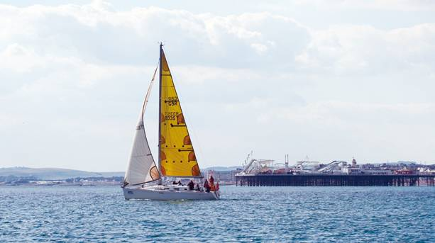 A sailing boat by Brighton Pier
