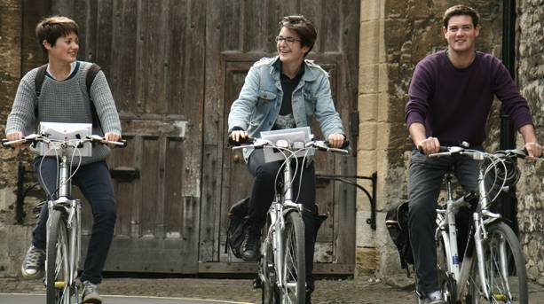 Three people cycling in Oxford