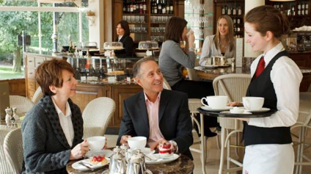 A couple enjoying afternoon tea at Bettys Tearoom in Harrogate