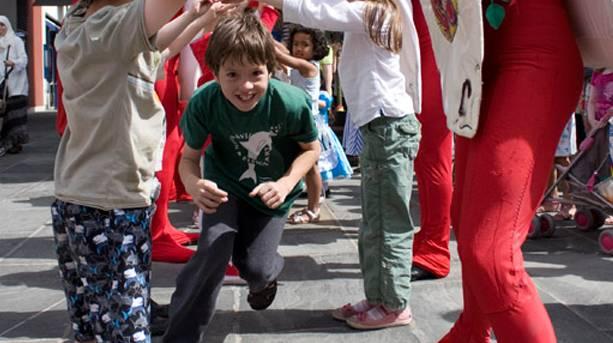 Child running in Alice in Wonderland game