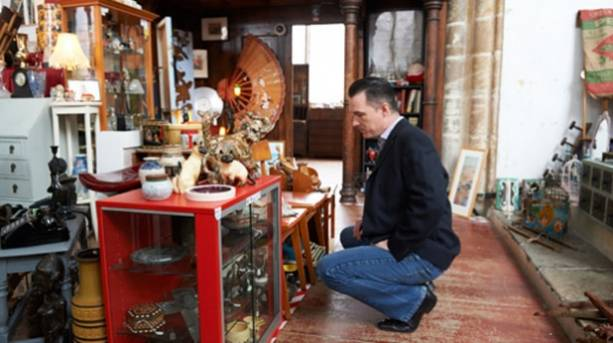 A man shopping for antiques in the Norwich Lanes