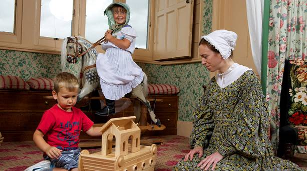 Children playing in the Nursery Wing at Audley End