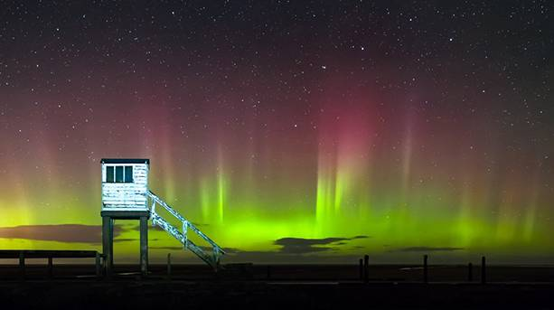Aurora Borealis over the causeway to the Holy Island of Lindisfarne