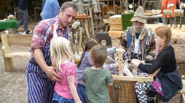 Children weaving at North Somerset Showcase event, NT Tyntesfield, Wraxall