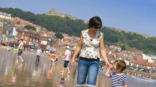 Mother and son on Scarborough South Bay