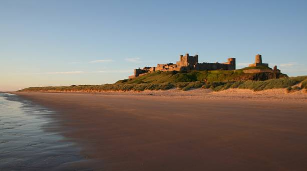 Bamburgh Castle at falling tide
