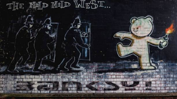 A picture of Banksy's The Mild Mild West wall art in Bristol