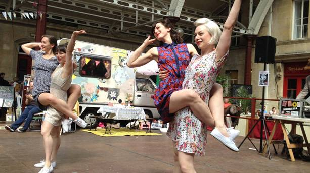 Women dancing at the Vintage and Antique market