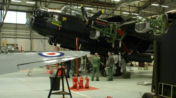 Technicians at work on the RAF BBMF aircraft