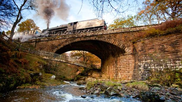 Steam train passes over Water Arc Bridge, near Beck Hole