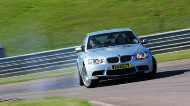 A BMW racing round the track