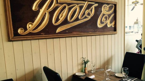 Boots sign at the Larder
