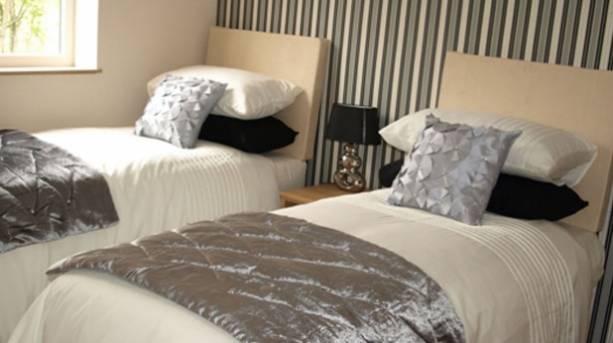 A bedroom at Brickhouse Cottages