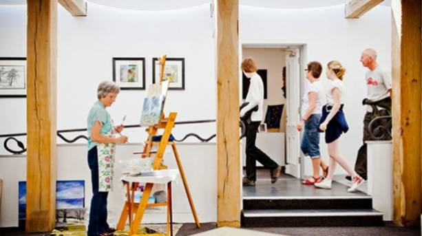 Artist at work in the Inspired by... gallery, at The Moors National Park Centre, Danby