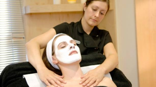 A lady enjoying a spa treatment at Burleigh Court
