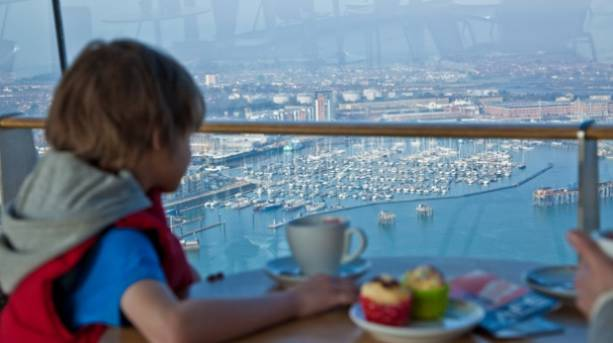 A boy looking down from the Café in the Clouds at Spinnaker Tower