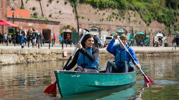 Couple canoeing along the quays, Exeter