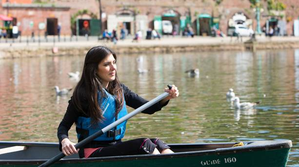 A woman canoeing along the quays, Exeter