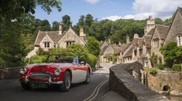 Vintage car driving through Wiltshire