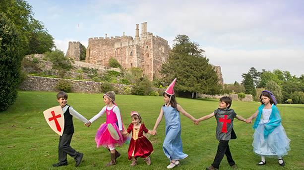 Children in fancy dress playing outside Berkeley Castle