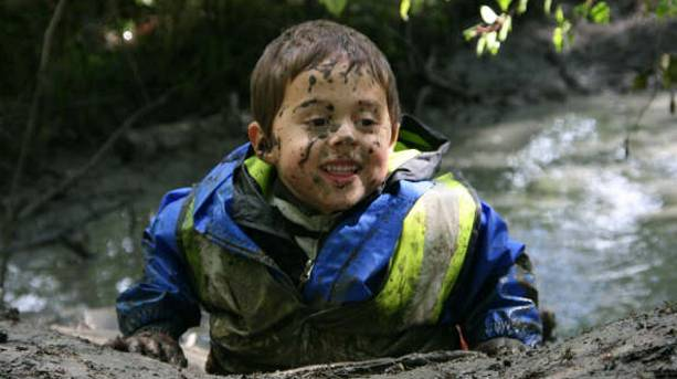 A muddy child at Shorne Woods Country park