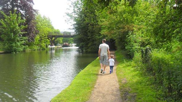 A father and son walk the Thames Path at Hurley Lock
