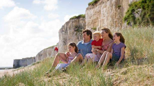 A family sitting on a chalk cliff at Botany Bay, Broadstairs