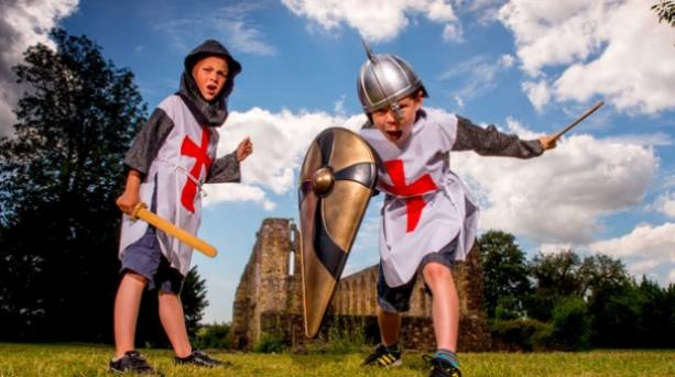Two boys dressed as knights at Battle Abbey