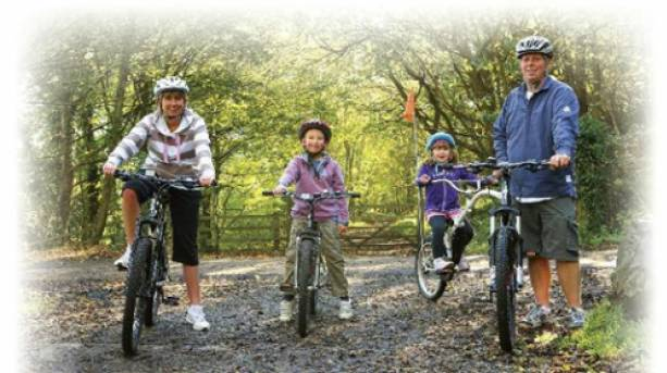 Family enjoying a bike ride on the Cinder Track