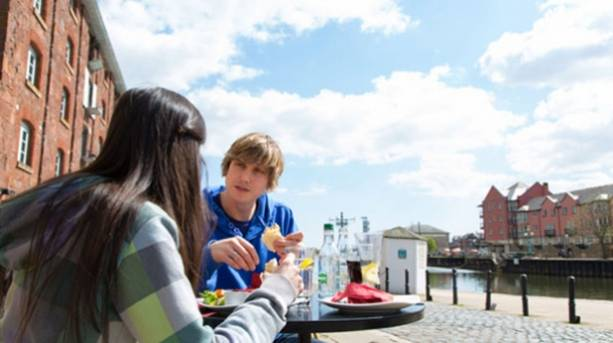 A couple alfresco eating on Exeter's quayside