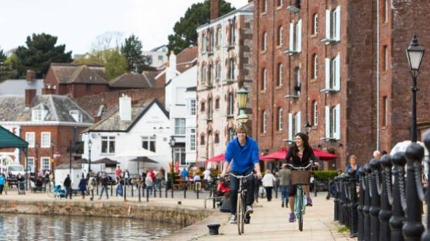 A couple cycling in Exeter