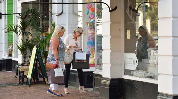 Two women shopping in Eastbourne.