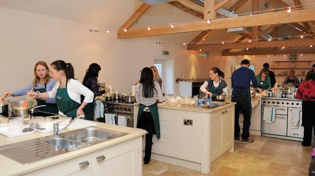 A class cooking at Brompton Cookery School