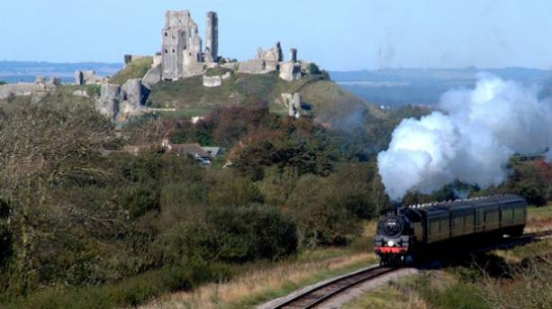Swanage Steam Railway driving past Corfe Castle to Swanage in Dorset