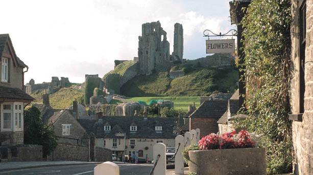 A view of Corfe Castle ruins from the village below