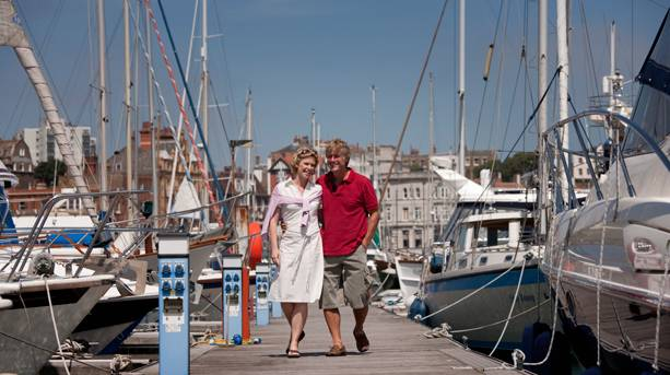 A couple walking through Ramsgate Marina