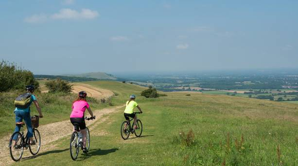 Three cyclists near Ditchling Beacon