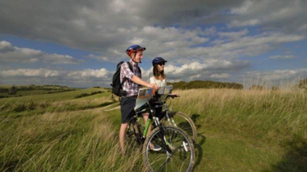 Two people cycling the Coastal Cultural Trail from Hastings to Eastbourne
