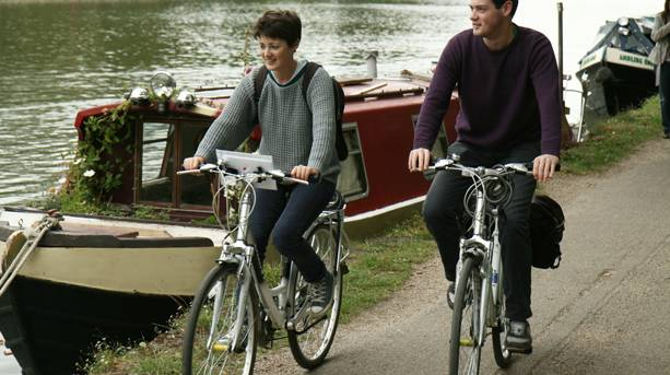 A couple cycling along the Thames