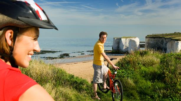 Two people cycling the Viking Coastal Trail