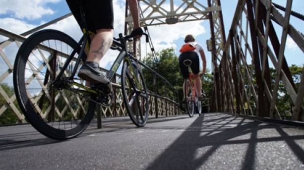 Two people cycling along the Clifton Suspension Bridge