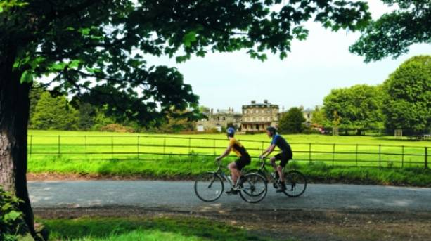 Cycling past Birdsall House, Howardian Hills