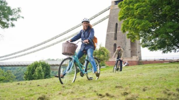 A woman cycling along the Clifton Suspension Bridge